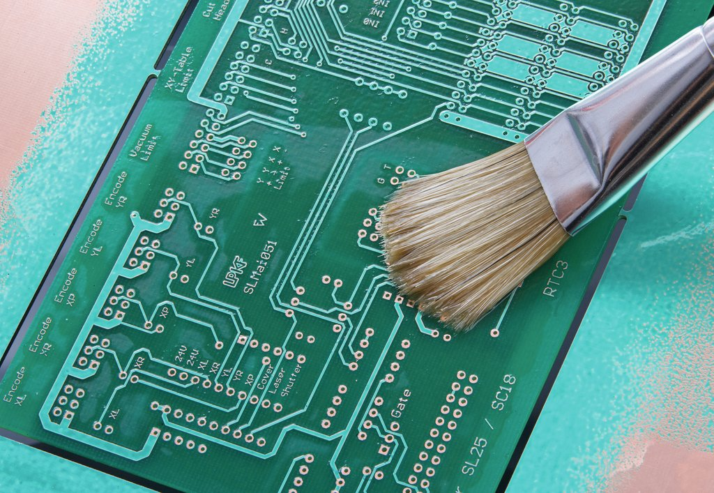 Conformal coating material being applied to pcb via brush